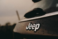 selective focus photography of black Jeep vehicle