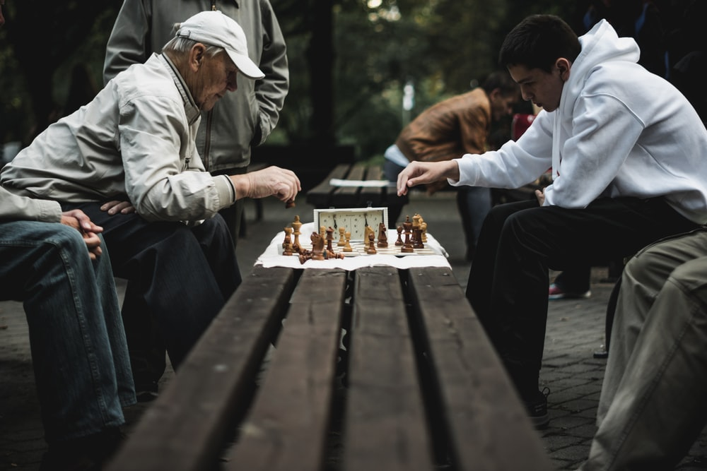 two men playing chess board game