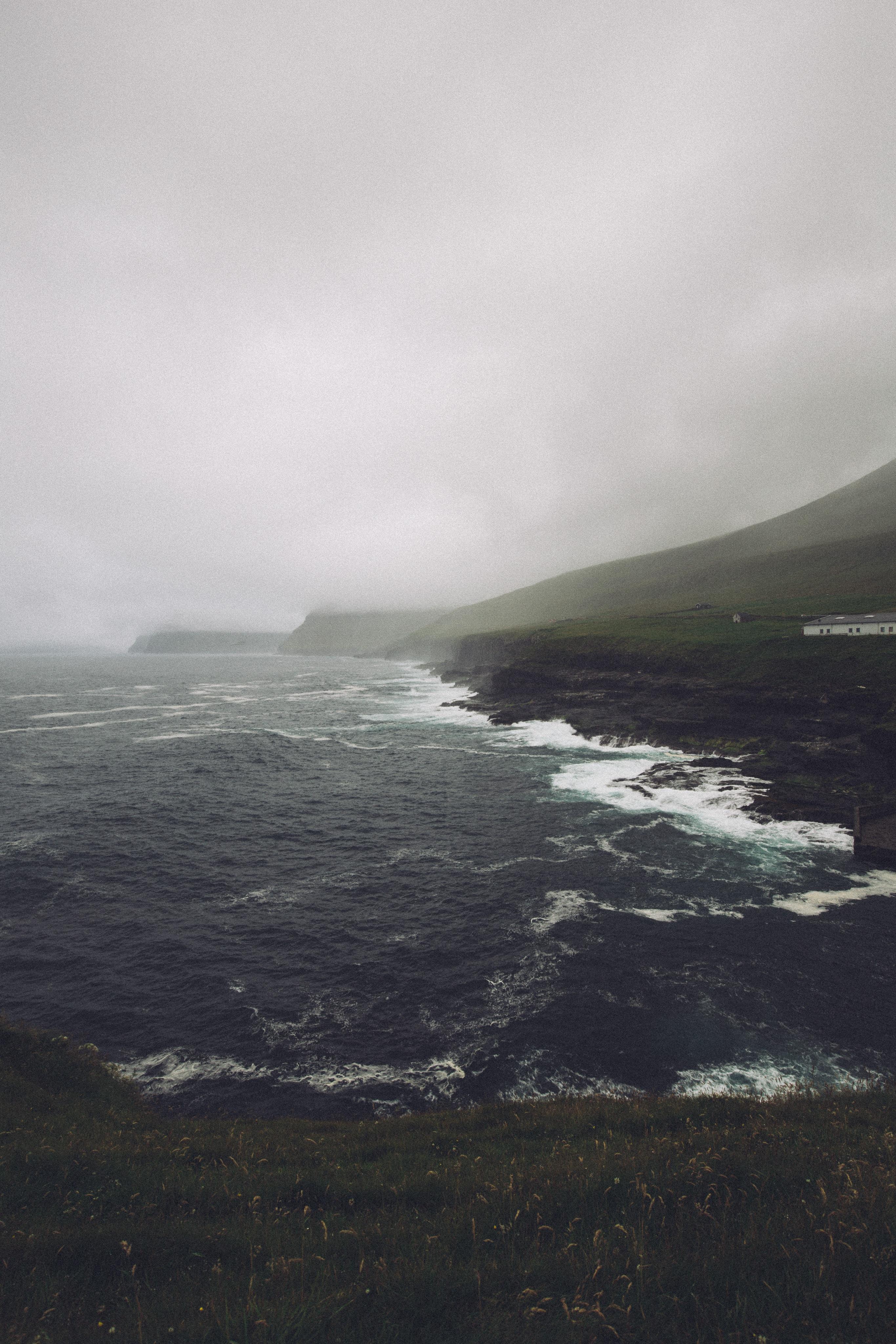 ocean near mountain