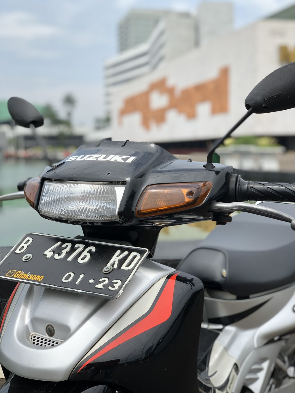 black and gray Suzuki motorcycle