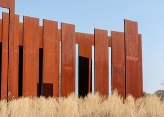 brown wooden fences under blue sky
