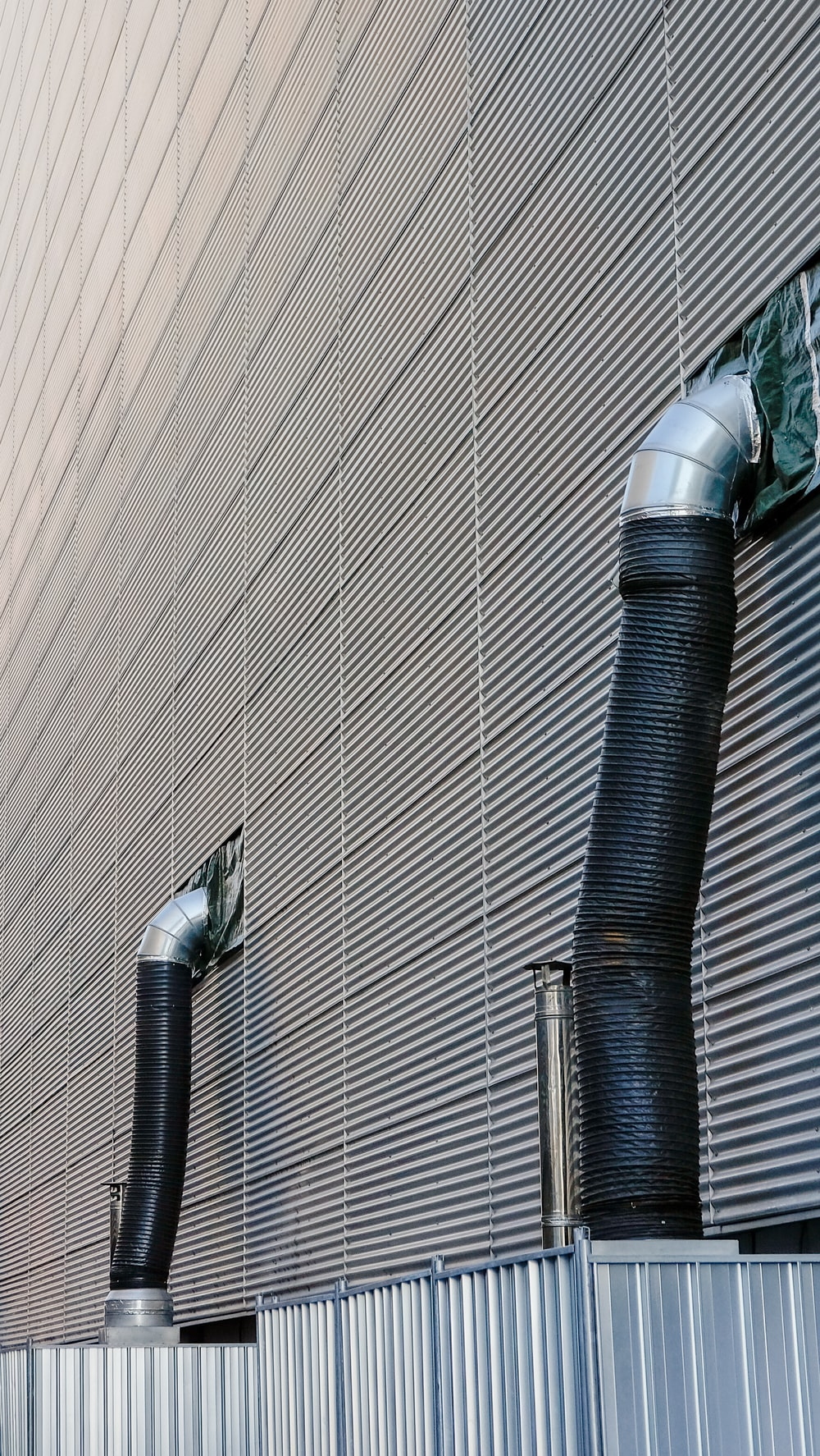 two gray and black hose outdoor