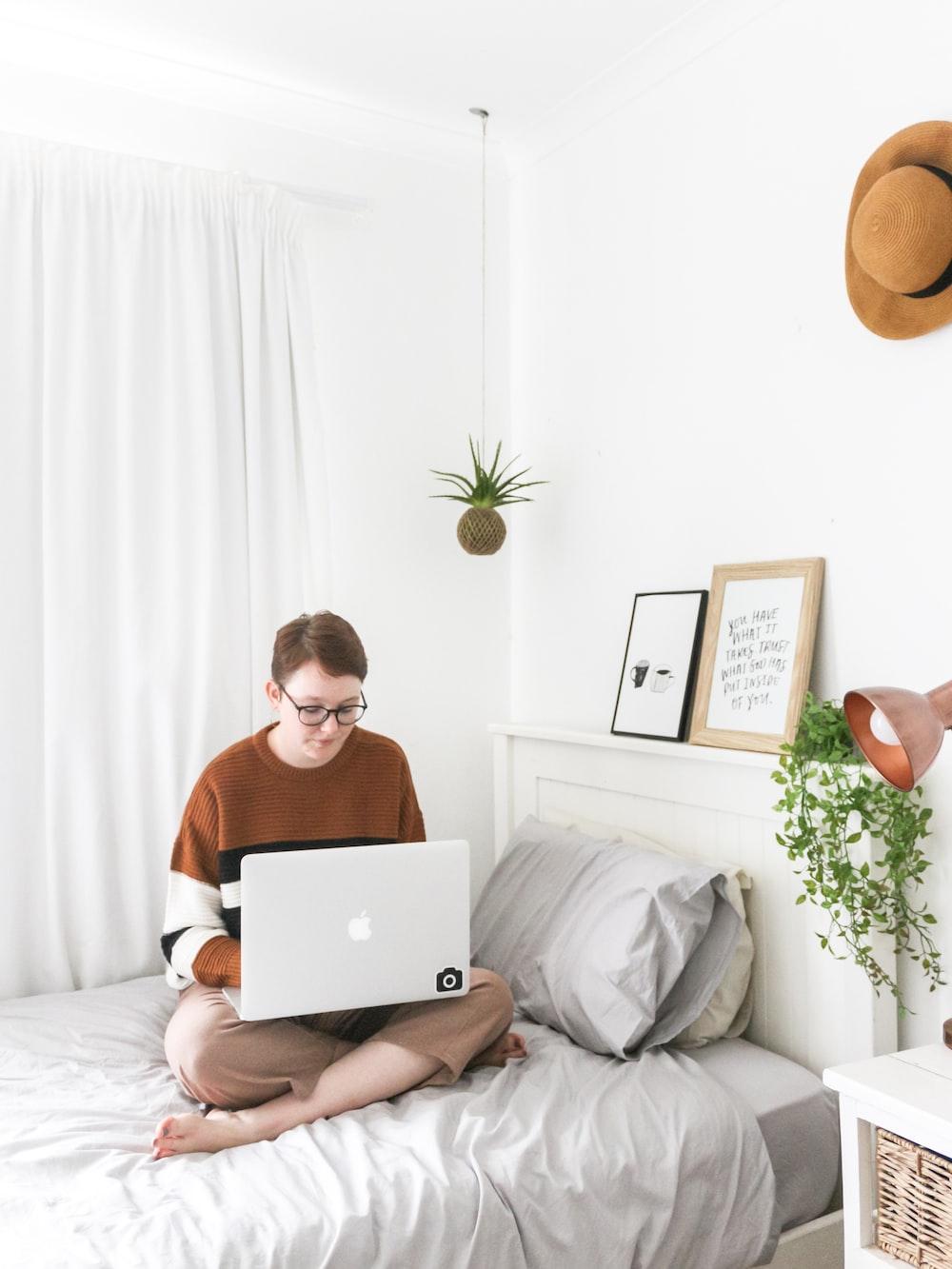man using white MacBook
