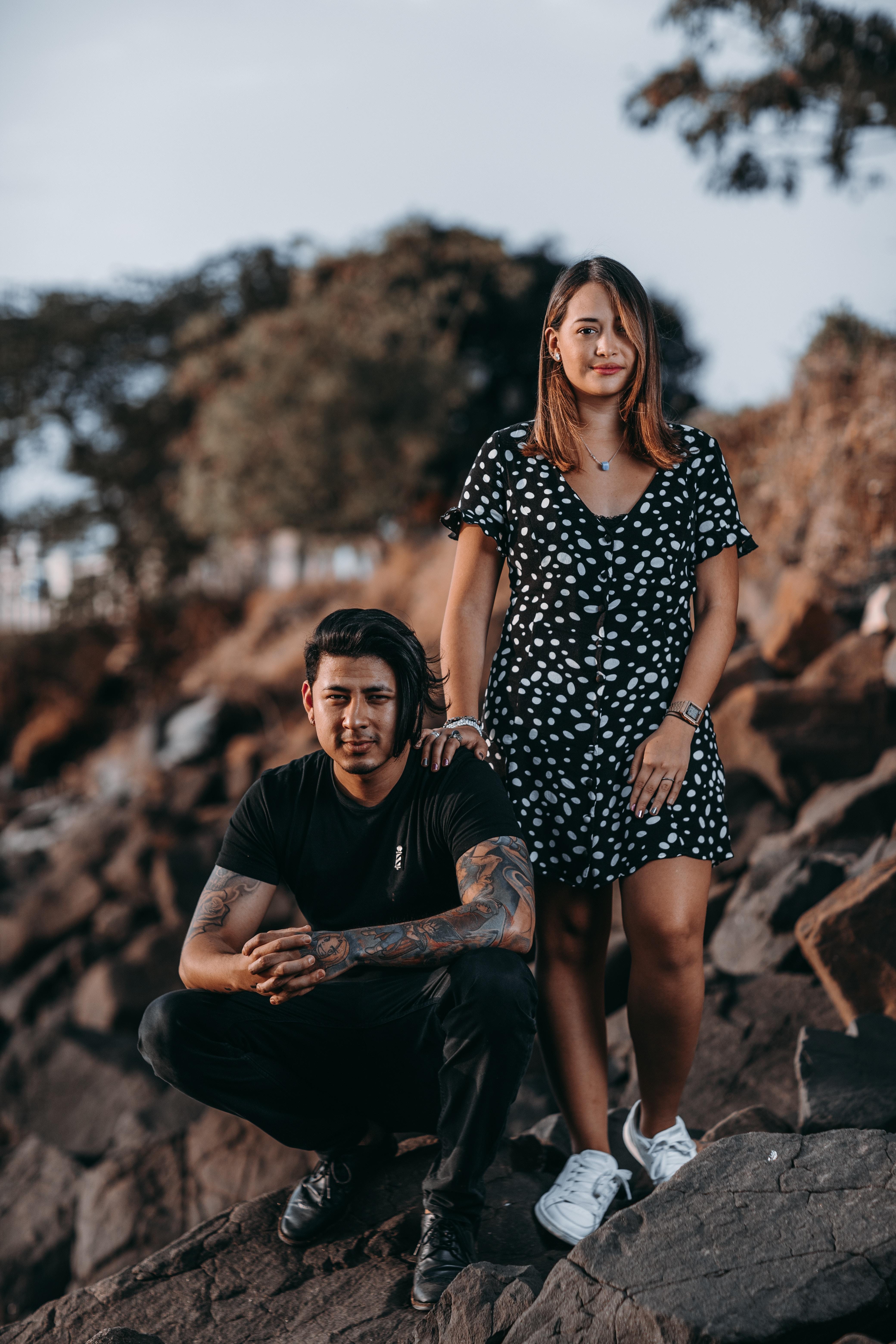woman standing beside man