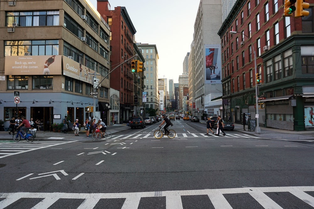 man riding bicycle at middle of street