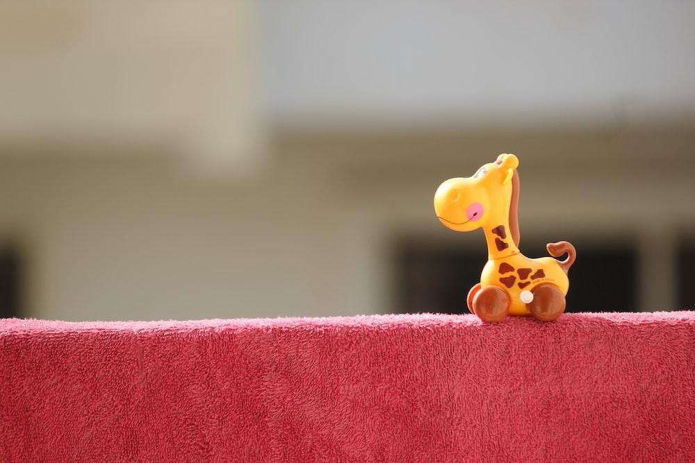 yellow and brown giraffe toy figure