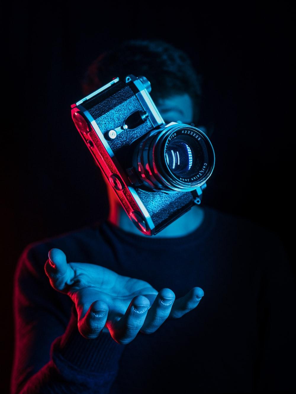 person holding DSLR camera
