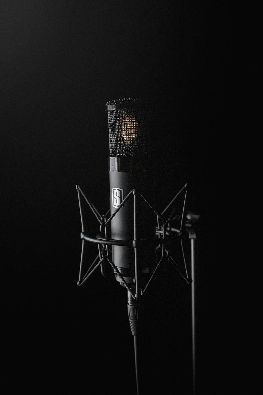 black condenser microphone on black background