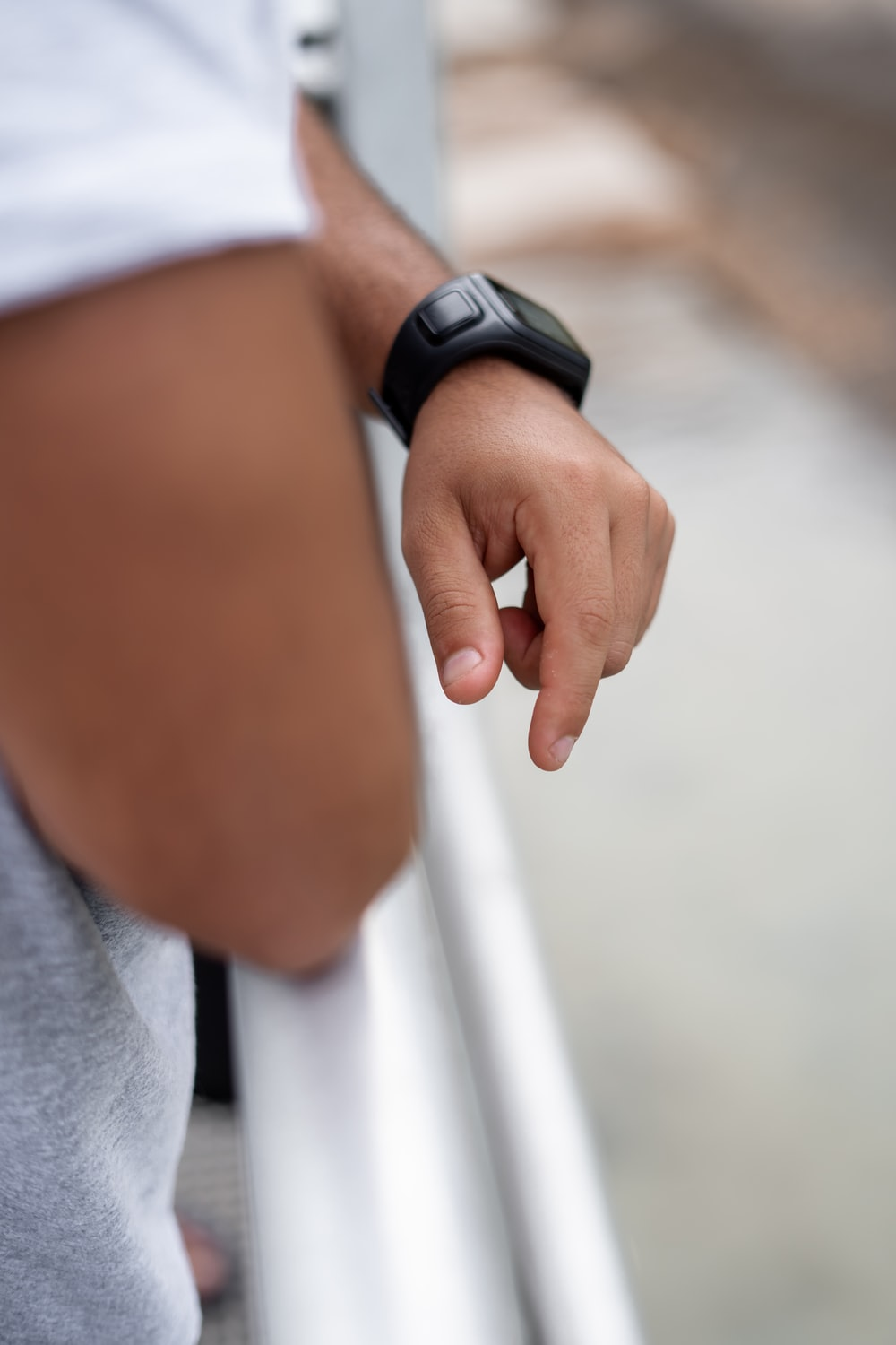 selective focus photography of man wearing black smartwatch