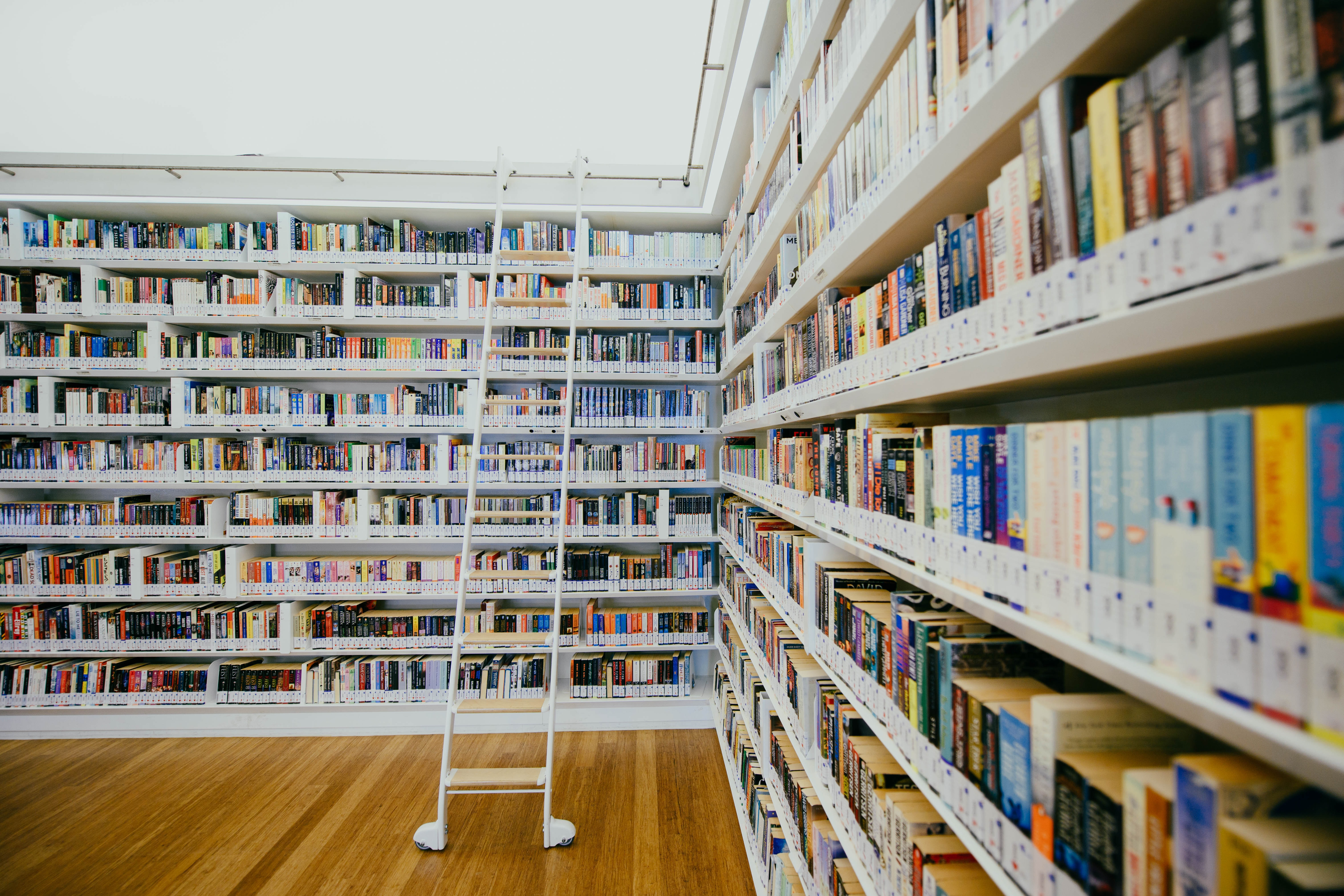 white book shelf filled with book in library