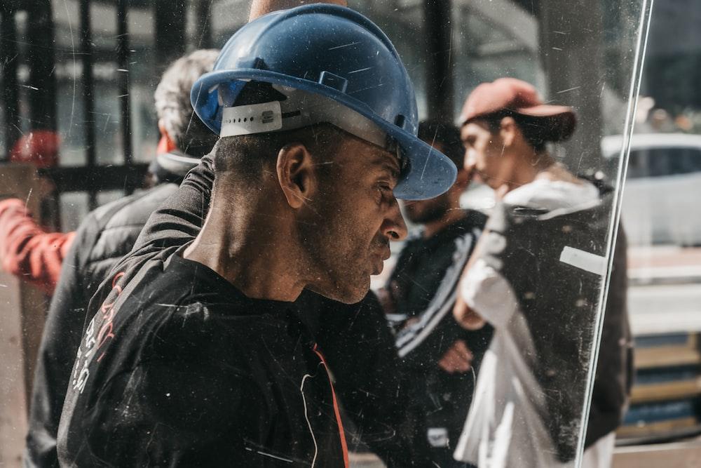 man wearing blue hard hat