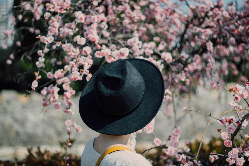 person wearing black hat