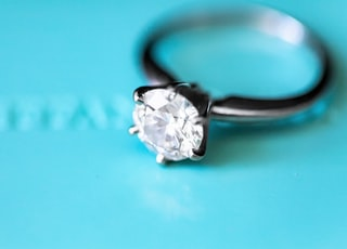 silver-colored ring with clear gemstone photo