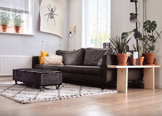 black two-seat sofa and coffee table inside room