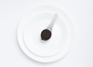 Oreo cookie on plate on white background