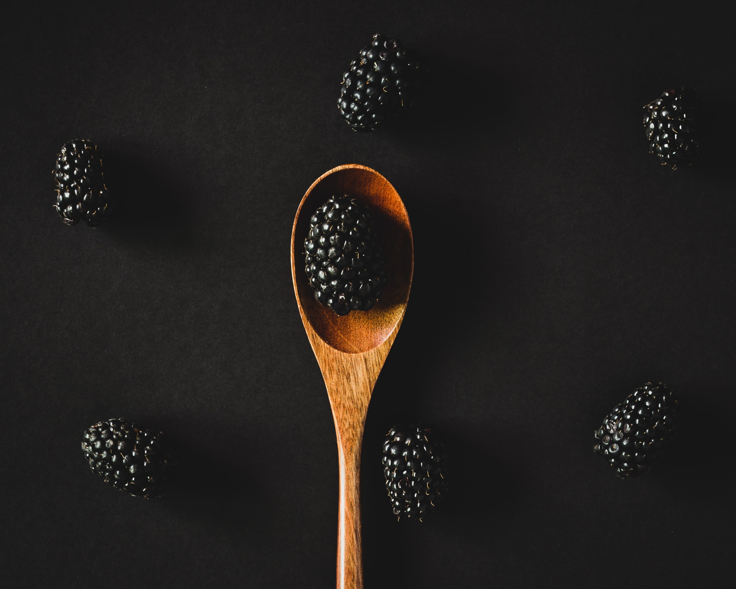raspberry on the wooden spoon