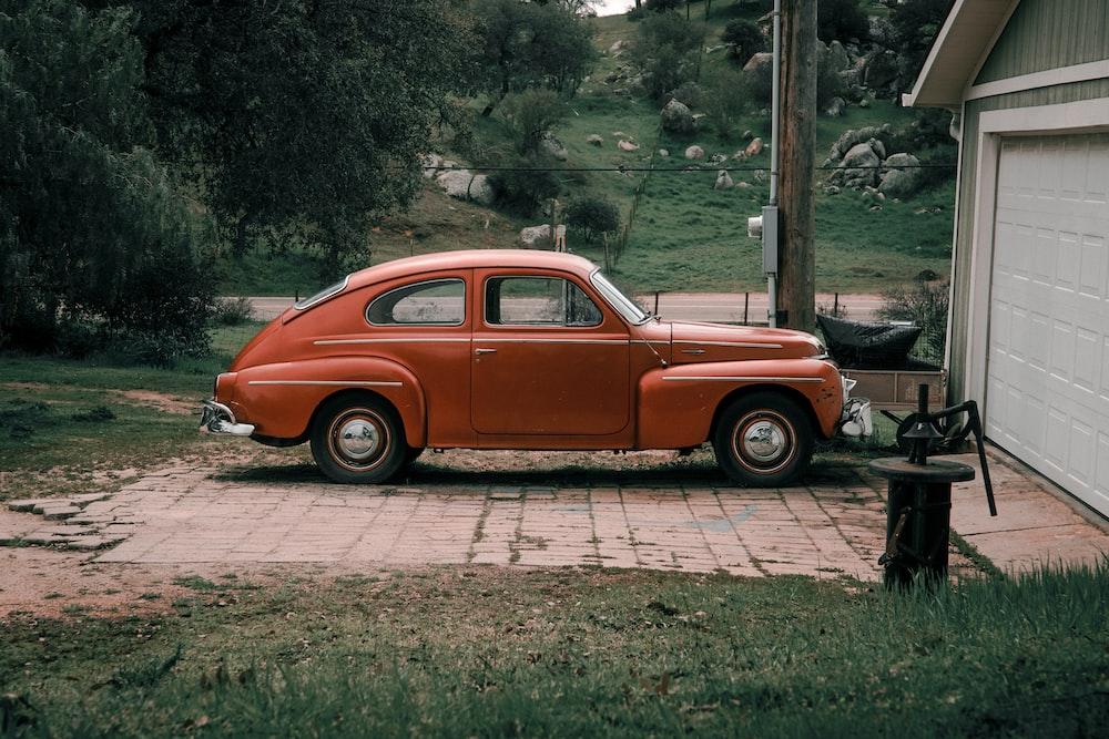 parked orange coupe