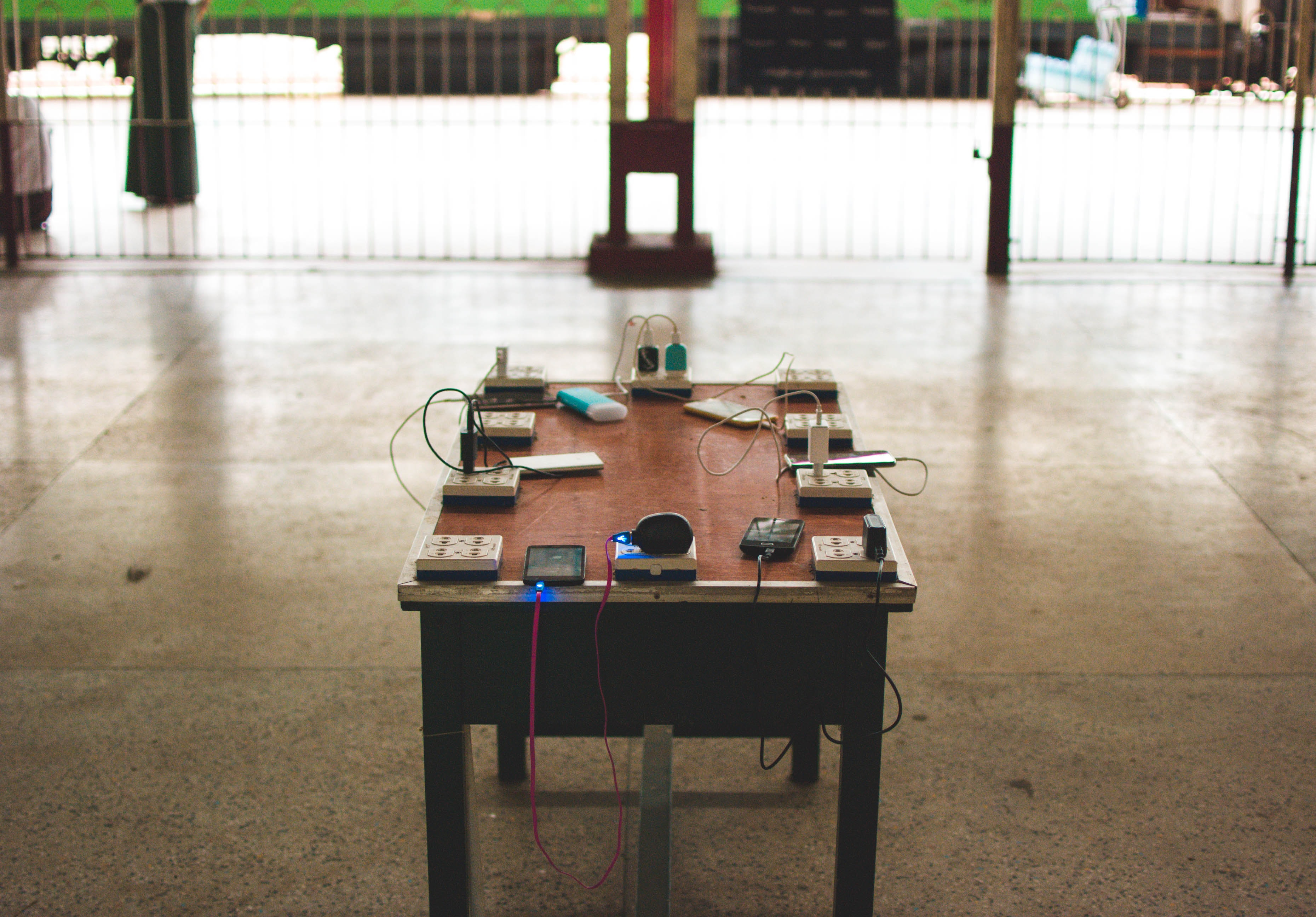 power sockets and travel adapters on brown wooden table