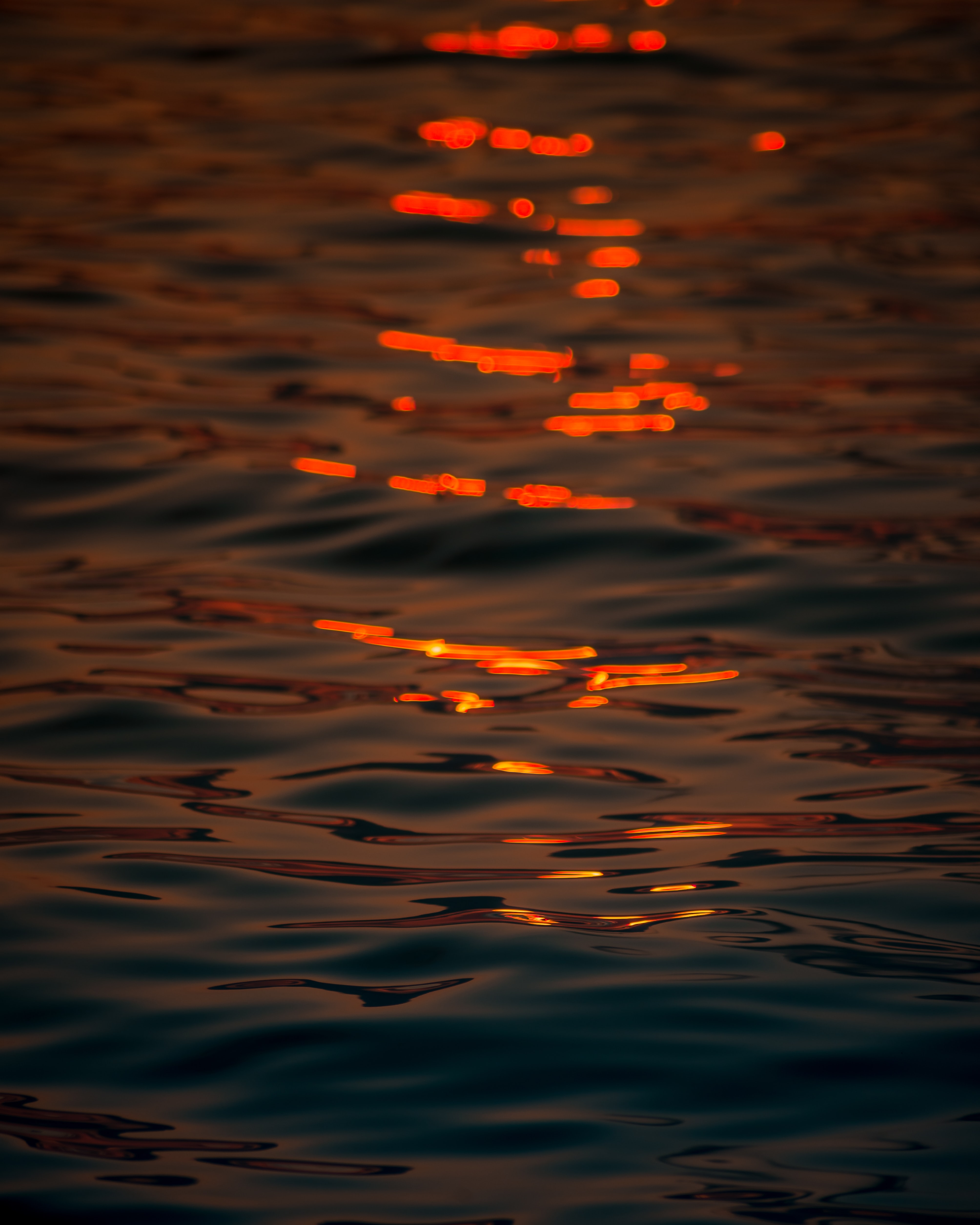 body of water with reflection of sun