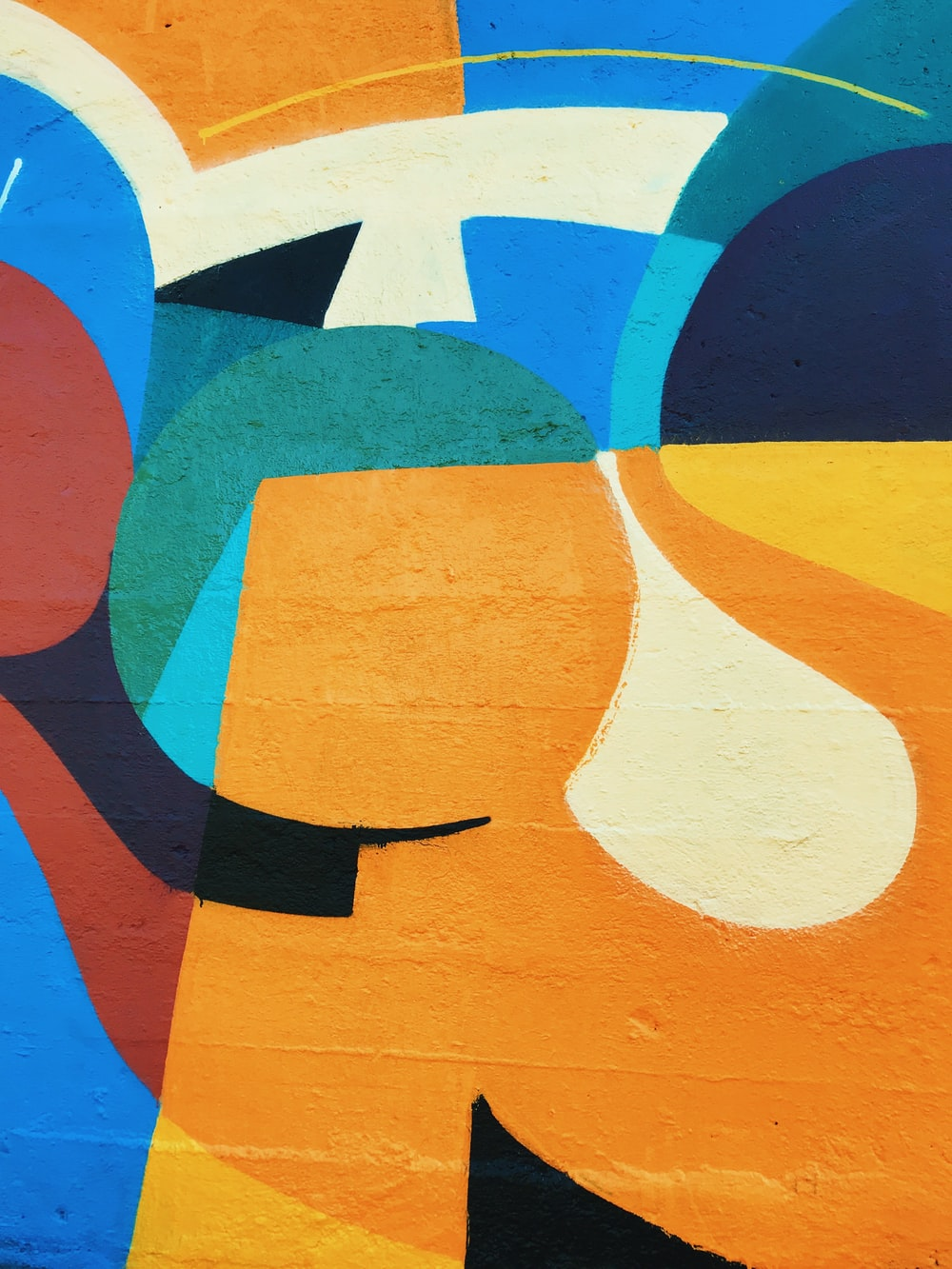 orange, blue, and white artwork