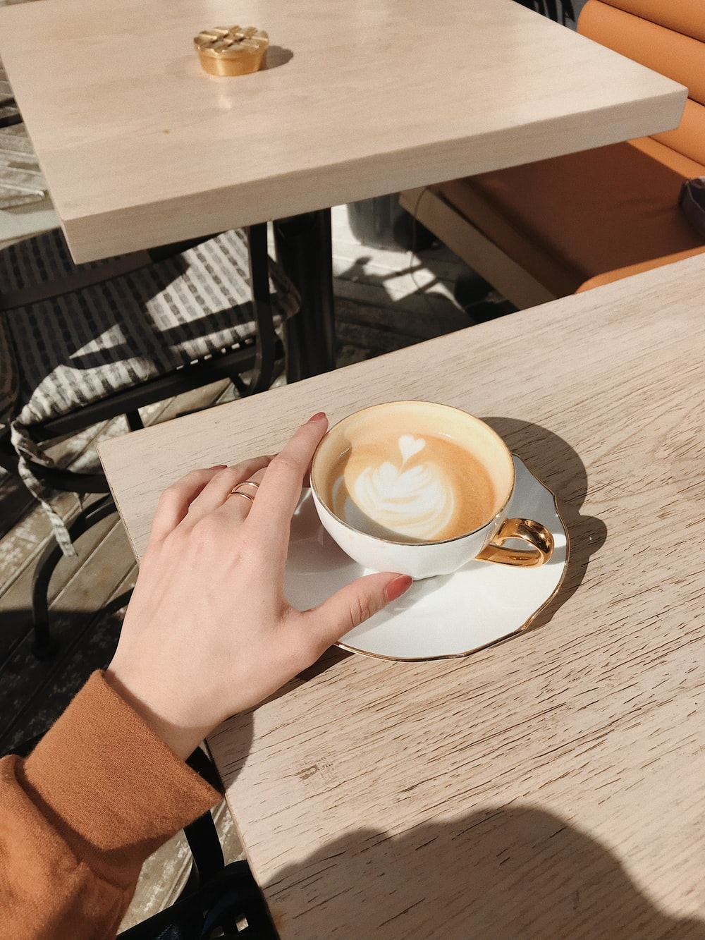 person holding cappuccino cup