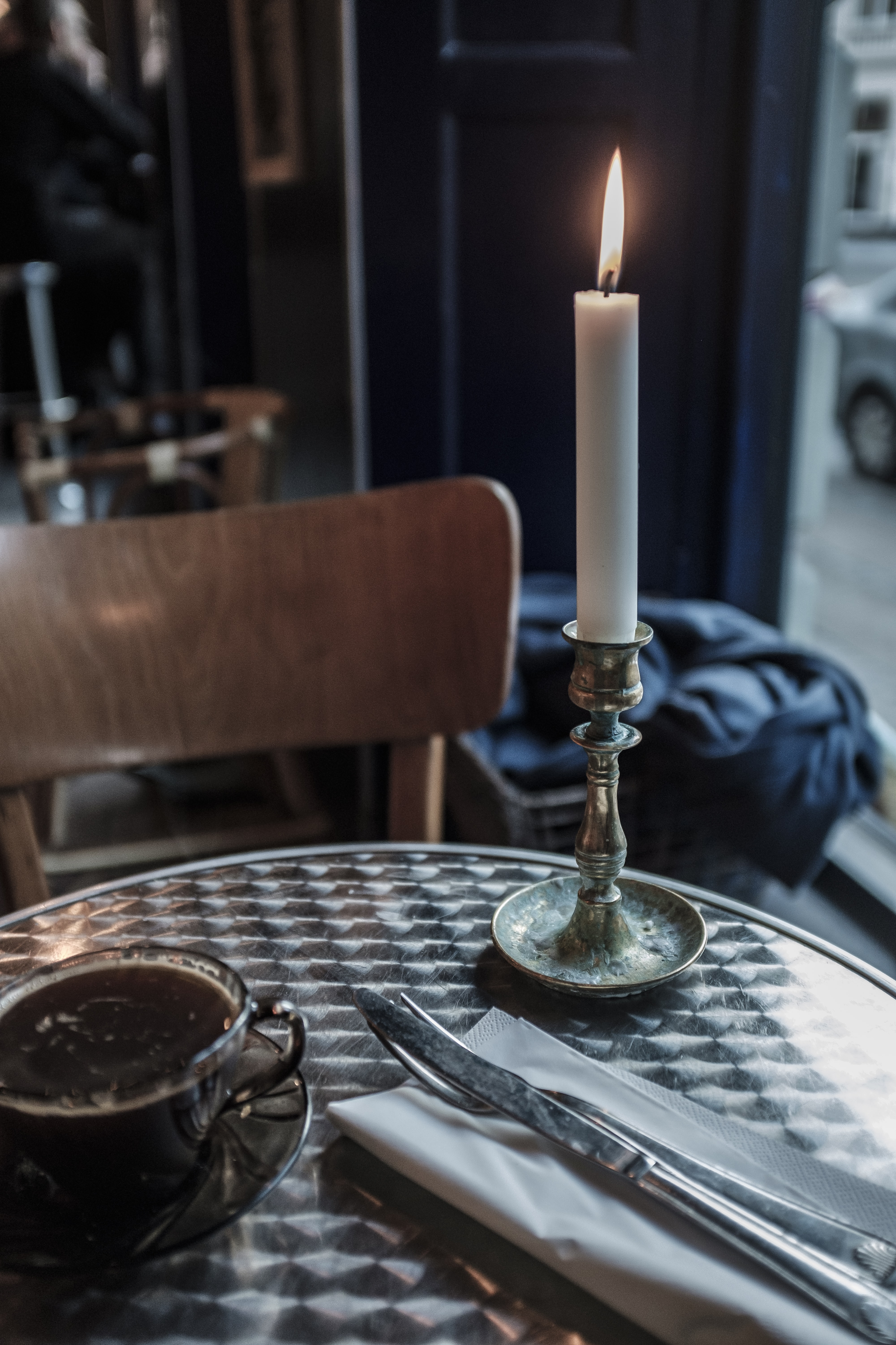 lighted candle on table inside room
