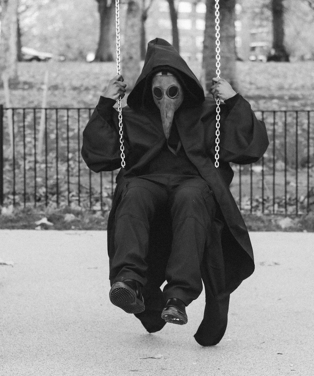 man wearing mask on swing chair