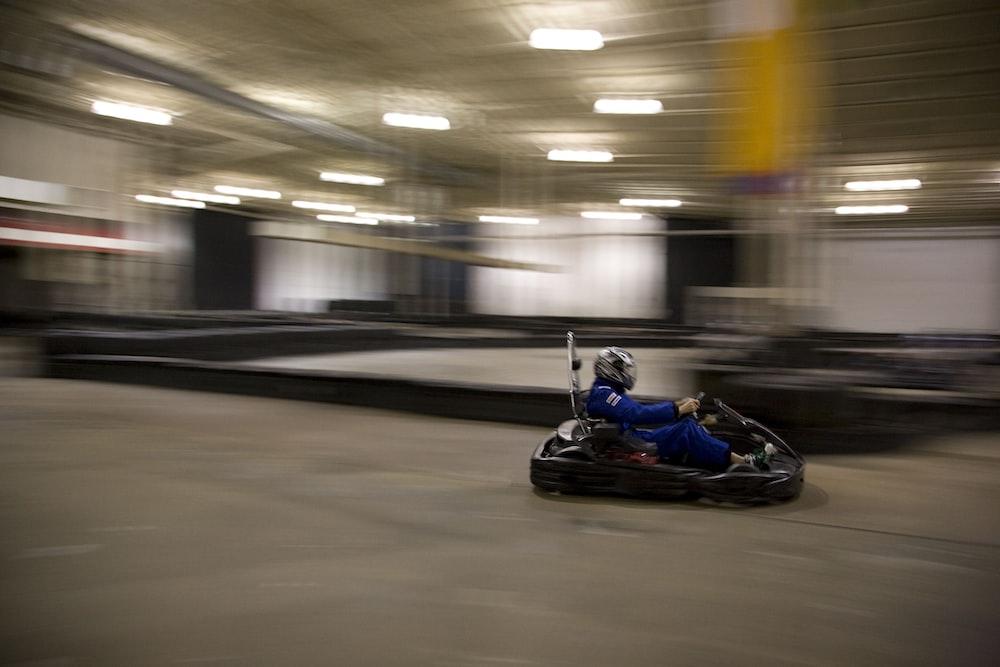 man riding on go-kart