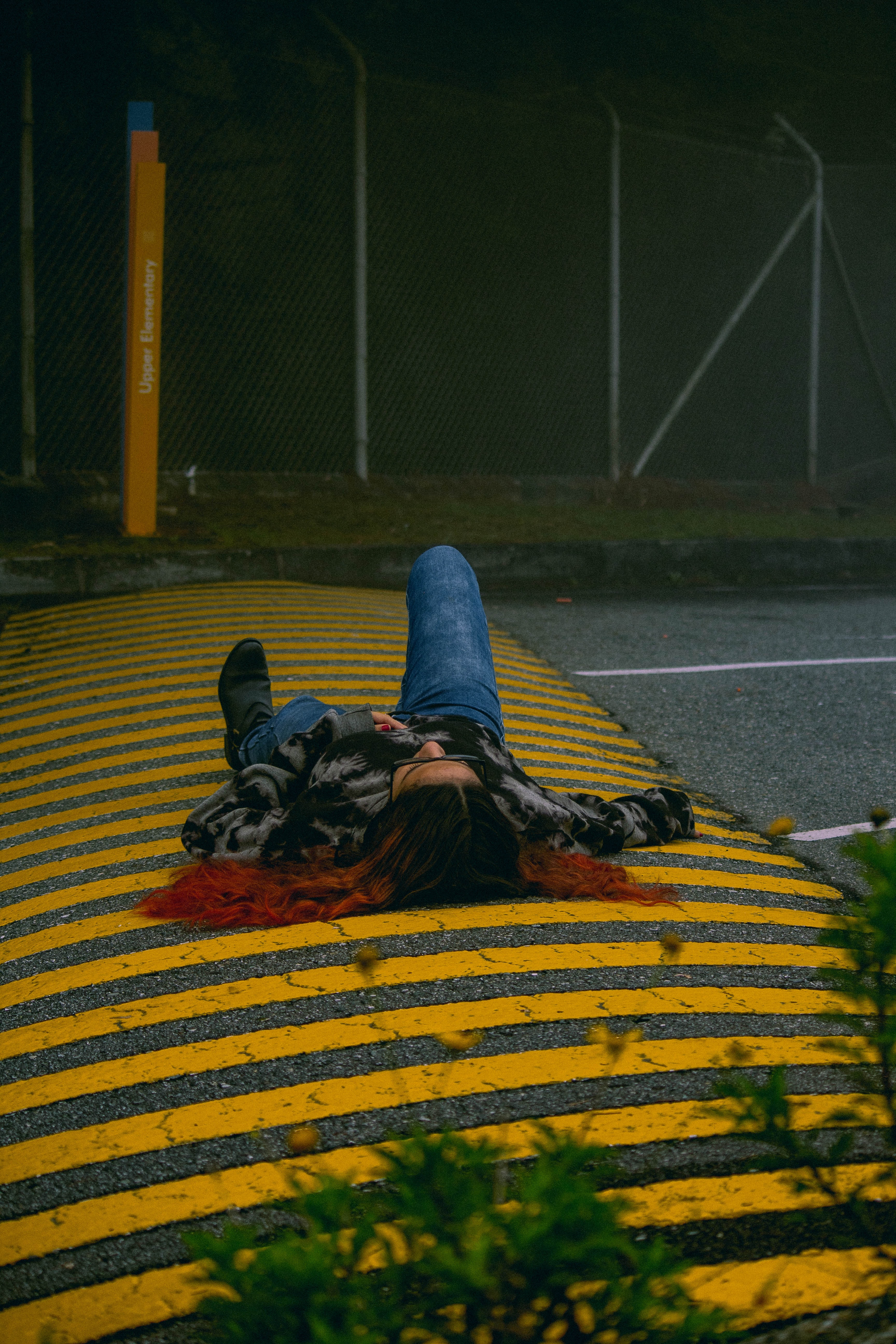 person lying on pedestrian crossing