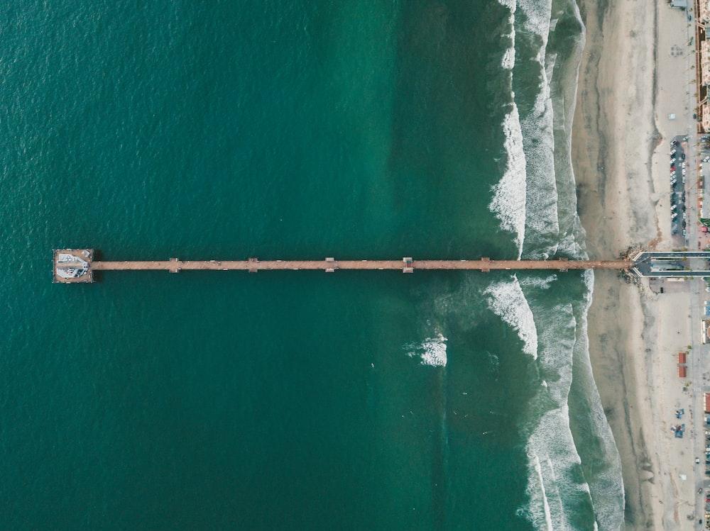 brown wooden dock aerial view