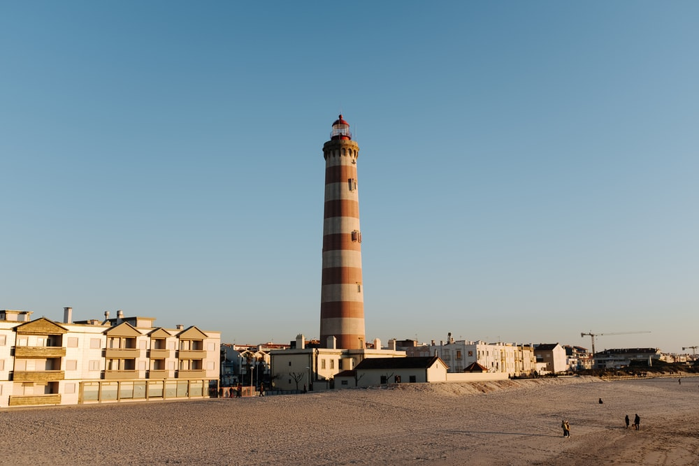 brown and white lighthouse under blue sky during daytime