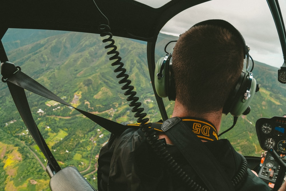 man riding helicopter