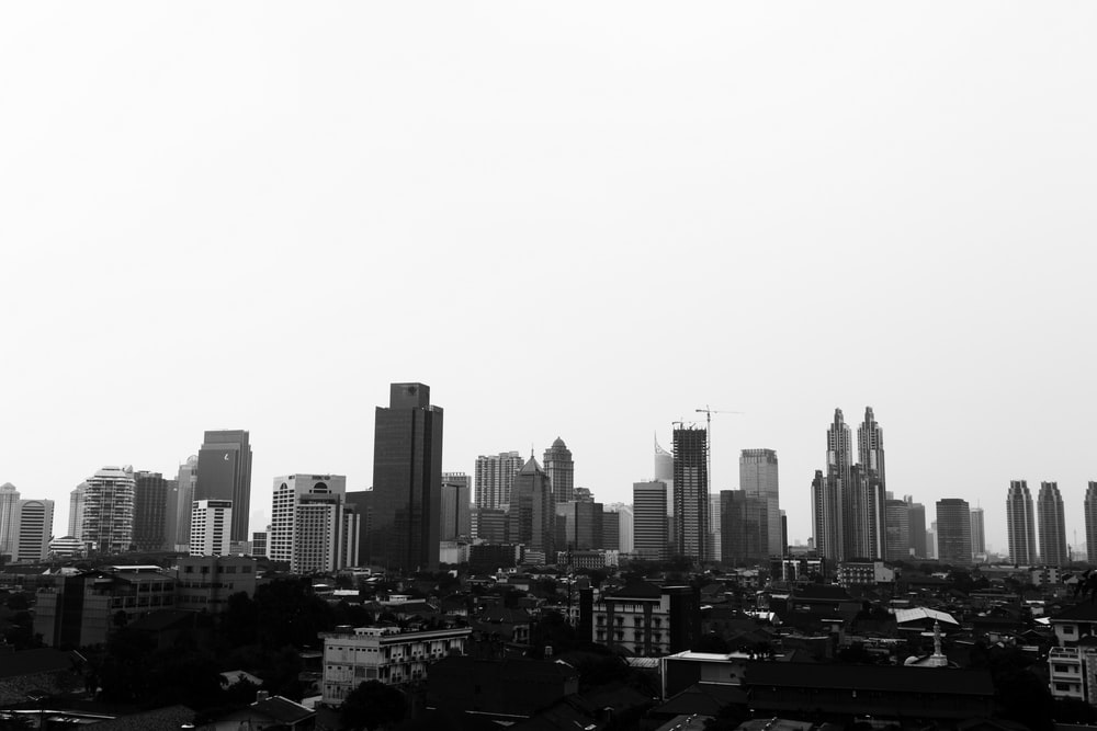 grayscale photo of high rise buildings at daytime