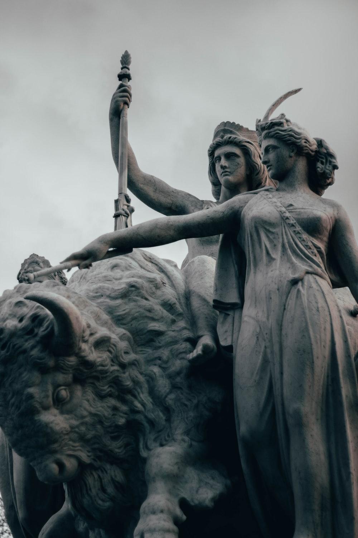 man holding sword statue