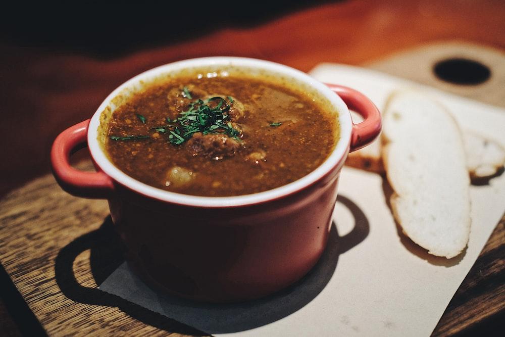soup in maroon ceramic pot