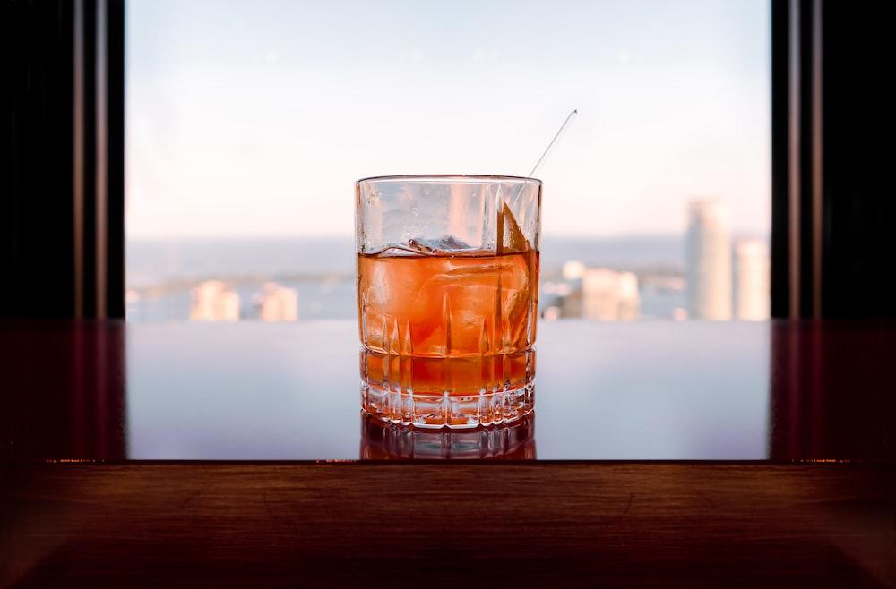 glass of liquor on table