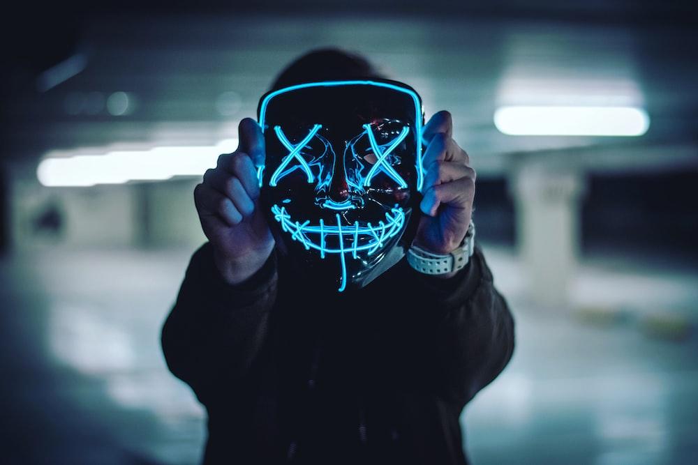 man holding full-face mask