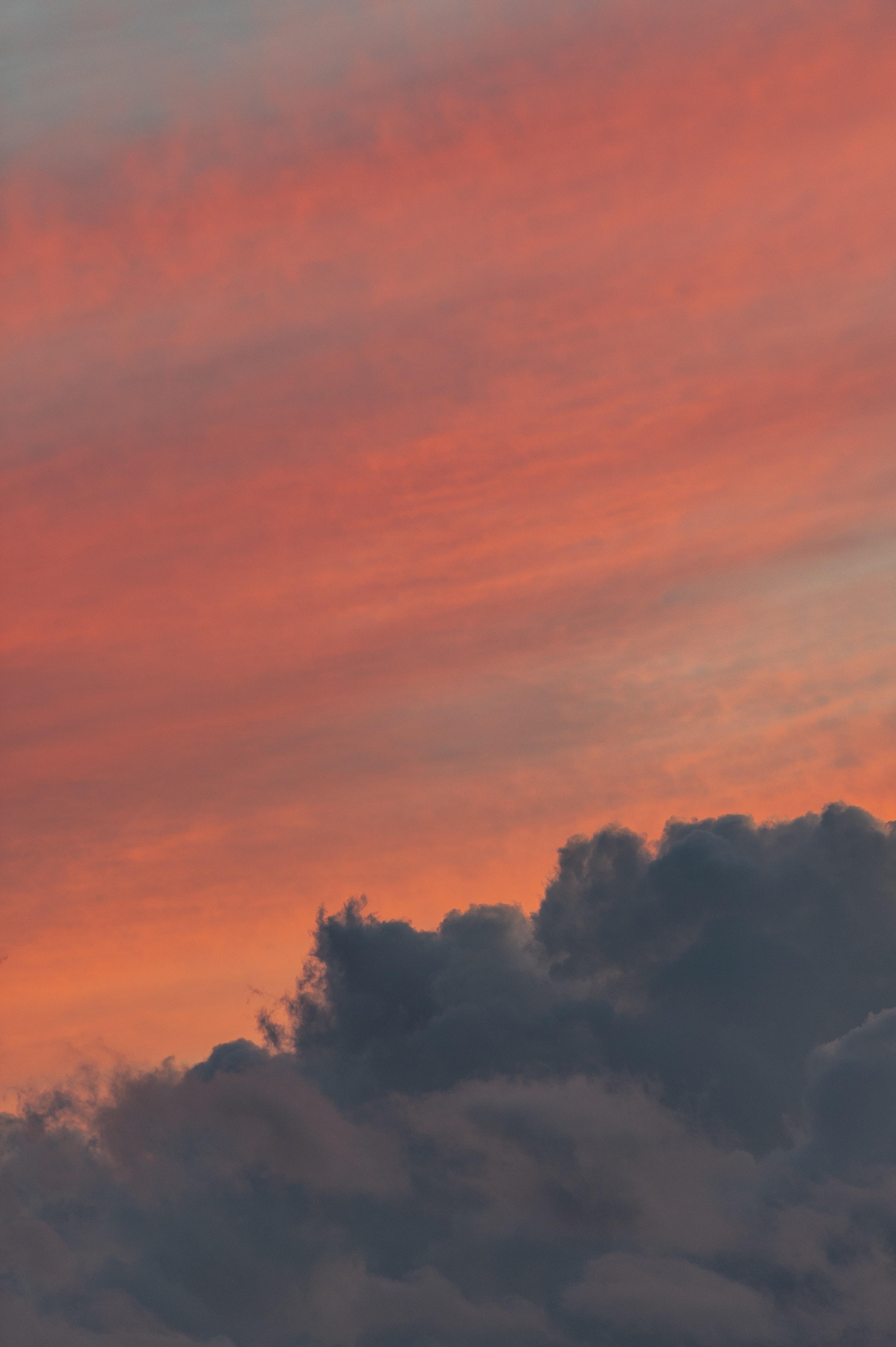 dark clouds during golden hour