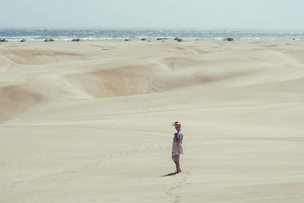person standing in desert during daytime