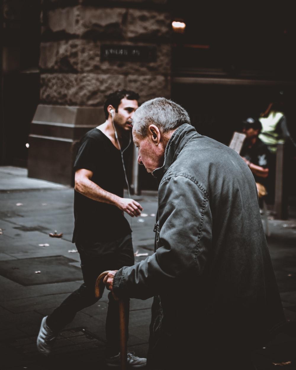 man holding walking cane
