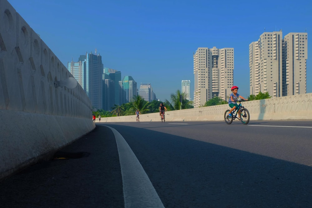 children riding bike on road