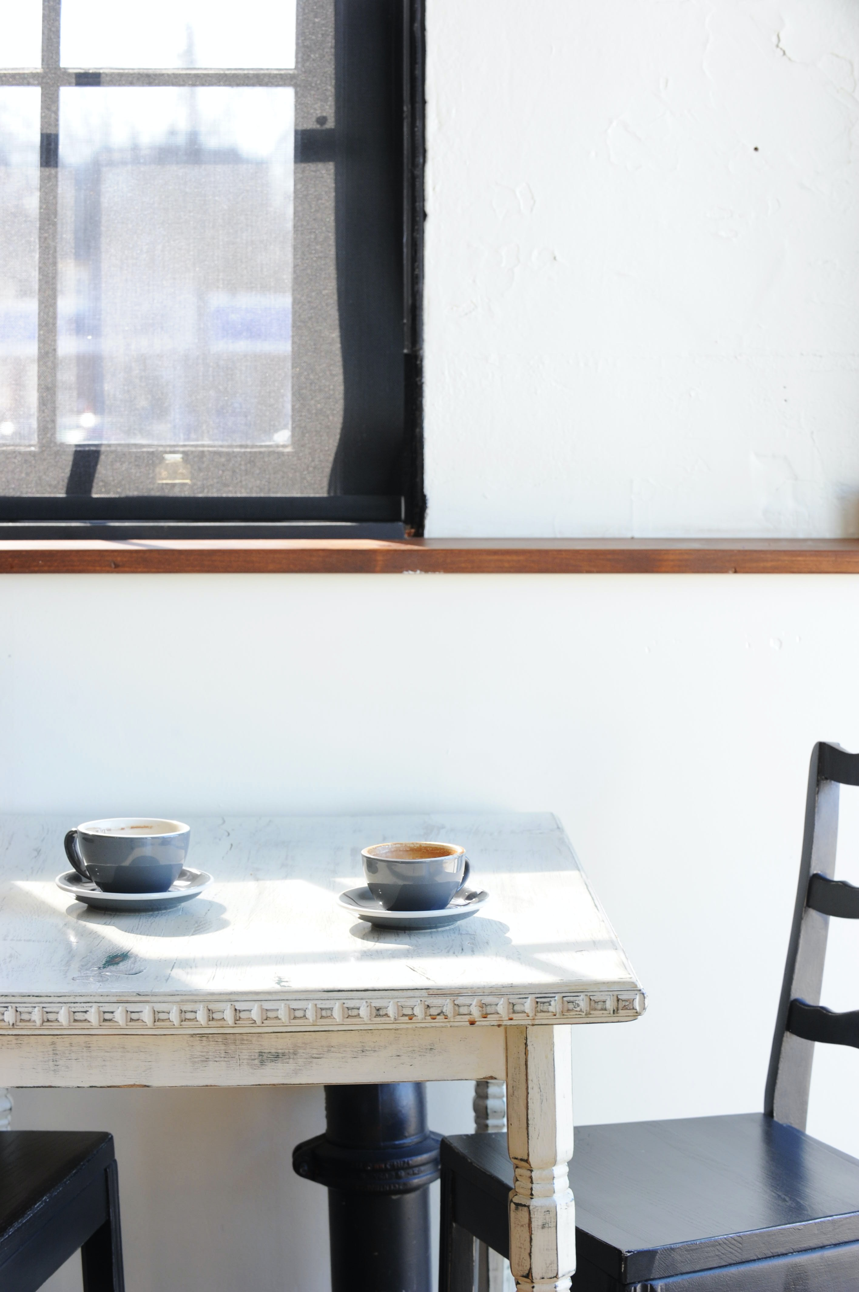 two cups on table
