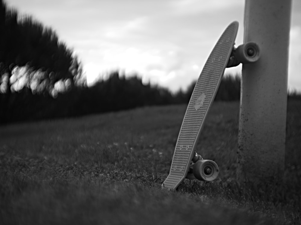 Penny board leaning on post