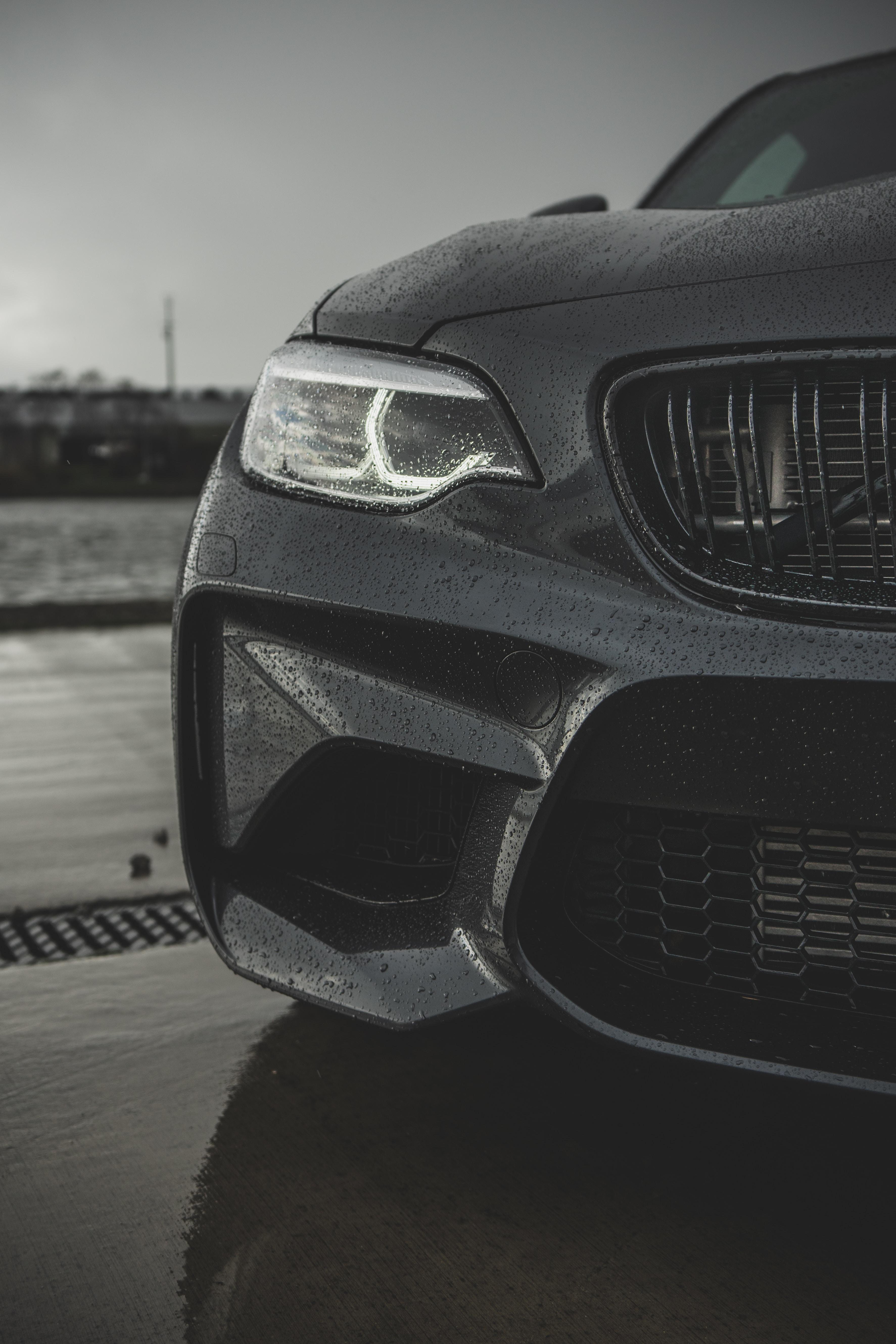 grayscale photo of headlight vehicle