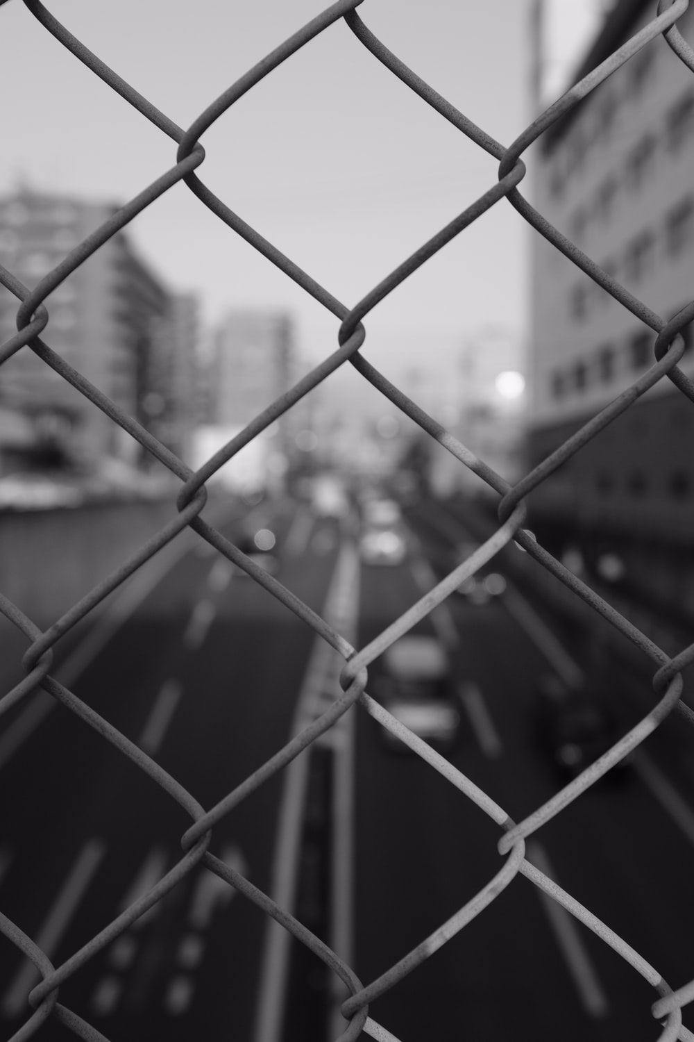 grayscale cyclone fence
