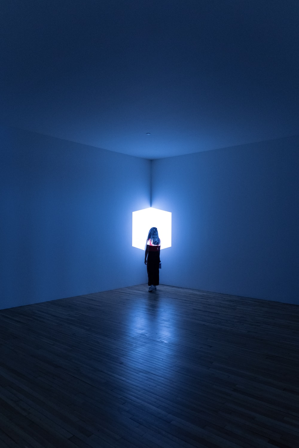 woman standing in the corner of the room