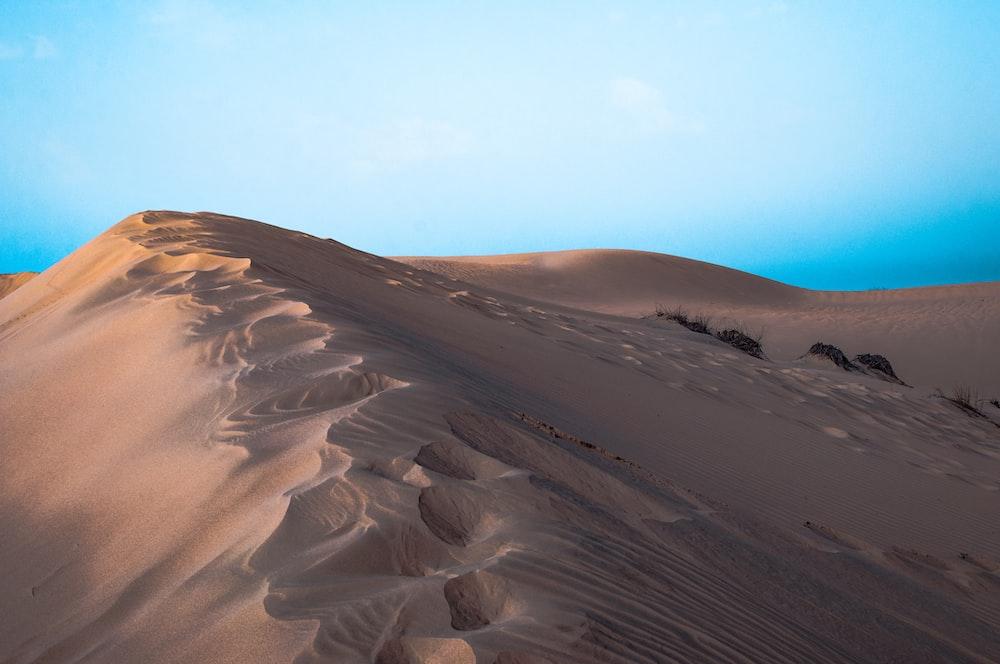 desert dunes photo during daytime