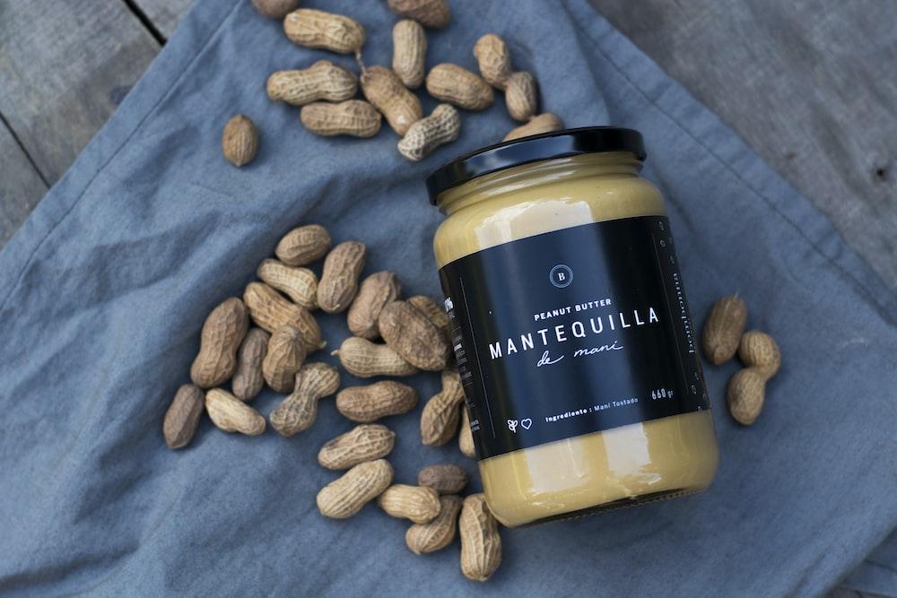 Mantequilla jar besides peanuts