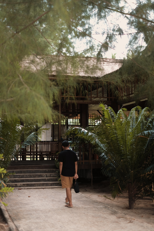 man walking on house