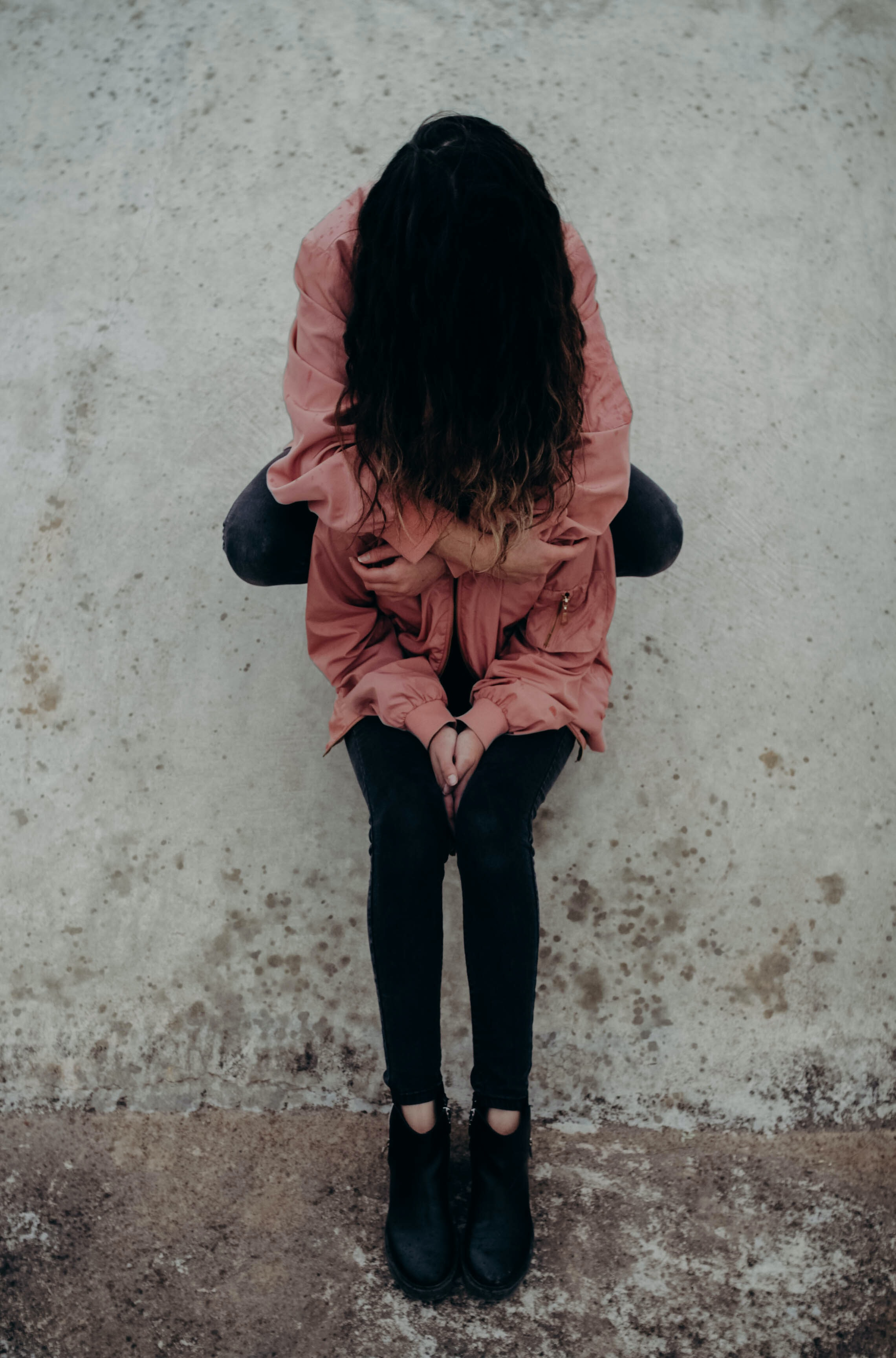 woman hugging person